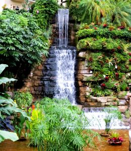 One of numerous waterfalls that help create the illusion of bringing the outdoors inside. -- Photo by Pat Bean
