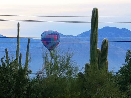 I wondered if this balloon was going to get high enough to miss the wires. It did. -- Photo by Pat Bean
