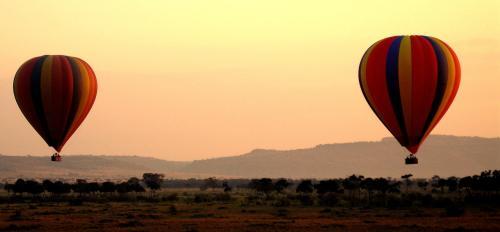 Hot air balloons up above the Serengeti Desert. -- Photo by Pat Bean