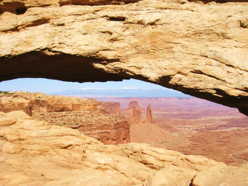 The view through Mesa Arch shows off a rich, red-rock background. -- Photo by Pat Bean
