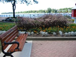 Just find me a bench, like this one that sits in Amherstburg, Ontario, beside an Erie River harbor and a book, and I can be happy for hours. -- Photo by Pat Bean
