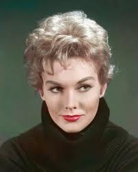 Kim Novak, when she was young and fit Americans' standards of beauty.