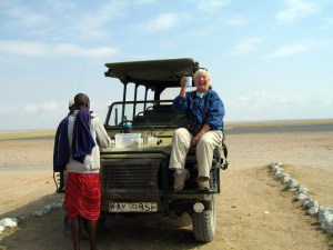My itchy feet took me to Africa, where I pretended I was John Wayne in Hatari at the Amboseli National Park Airport in Kenya. -- Photo by Kim Perrin