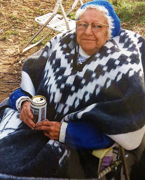 Mother became a Dr. Pepper woman in her later years. She had a beer at 10, 2 and 4 o'clock. This picture was taken a couple of years before she died when I took her on a family camping trip to Zion National Park. She sat around the campfire with us, but then I took her to a nearby motel to spend the night in comfort. I love you, Mom. -- Photo by Pat Bean