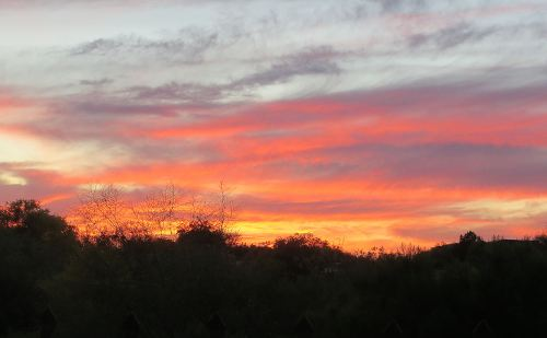Last night's sunset as seen from my balcony. Sometimes the thoughts that pop into my thoughts are as explosive as this. -- Photo by Pat Bean