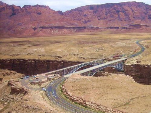 This is an aerial view of the two Navajo Bridges, with the original one on the left. -- Wikimedia Photo
