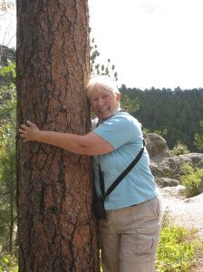 Me being silly and hugging a tree in Custer State Park in South Dakota.