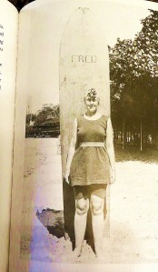 Agatha Christie with her surf board in Hawaii.